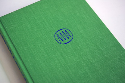 70s book cover, ama logo, foil stamped book cove3r, casewrap, seventies design